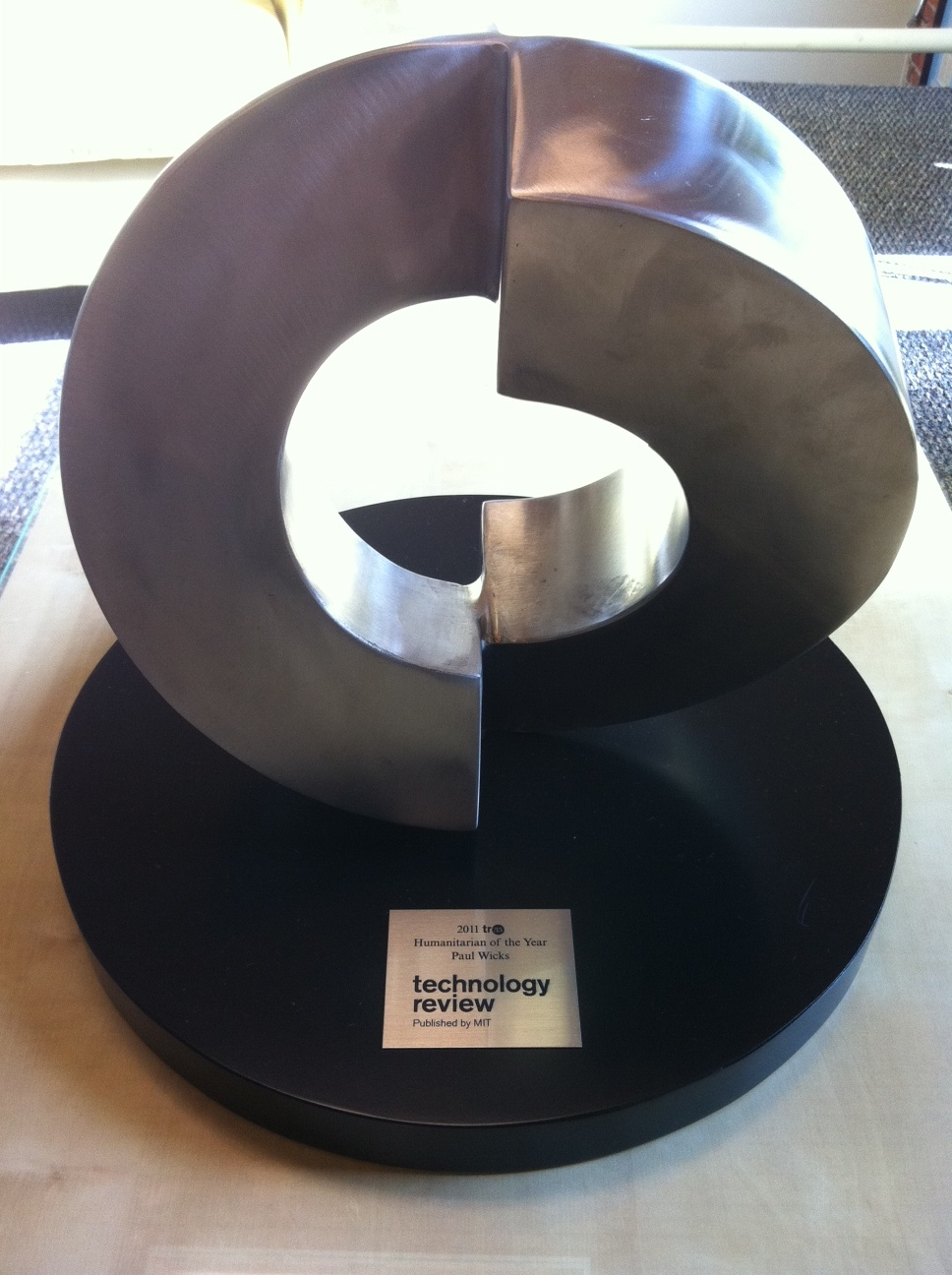 2011 Humanitarian of the Year Award Trophy Presented to Dr. Paul Wicks, PhD