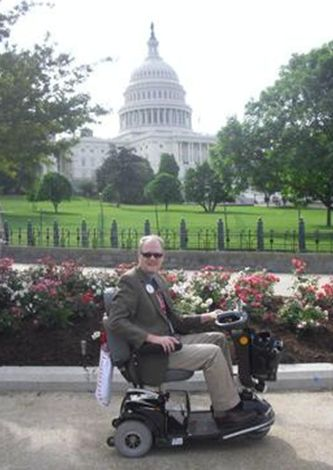 ALS member Persevering in front of the US Capitol, where he was participating in ALS Advocacy Day 2011.