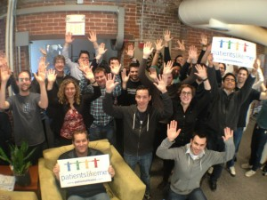 rare-disease-day-2013-plm-employees-raising-hands