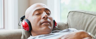 Man listening to podcast, relaxing