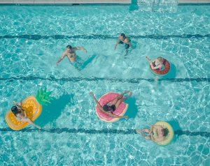 People in pool swimming